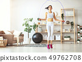 young woman doing fitness and sports at home 49762708