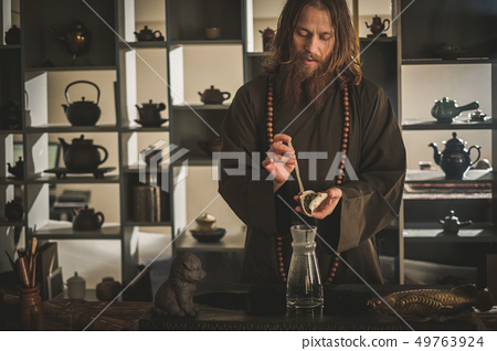 Tea ceremony is perfomed by tea master 49763924