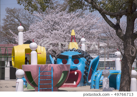 Funny play equipment in the park 49766713