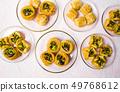 Various Arabic desserts on plates 49768612