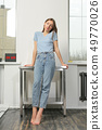 slim woman in casual outfit indoors 49770026
