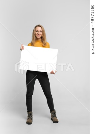 Smiling young woman with poster 49771560