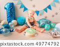 Adorable baby boy celebrating his first birthday. 49774792