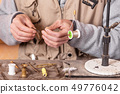 Man making trout flies. Fly tying equipment and material for fly fishing preparation. 49776042