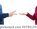 playing rock paper and scissors game 49789134