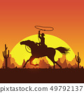 Silhouette of a cowboy riding horse at sunset 49792137