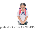 Cute girl student making a bow isolated 49796495