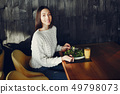Beautiful girl sitting in a cafe 49798073