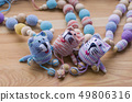 Knitted pink striped handmade crafted cat. 49806316