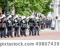 Guards line up in the bright sunshine Cite of London, England 49807439