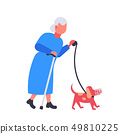 senior woman walking with dog in muzzle grandmother and animal pet having fun best friend concept 49810225