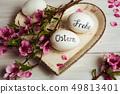 Frohe Ostern written on eggs 49813401