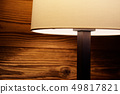 Light of a floor lamp on a wooden wall 49817821