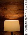 Light of a floor lamp on the wooden wall 49817823