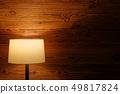 Indoor lighting by floor lamp at wooden wall 49817824