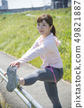 Woman stretching outdoor sports 49821887