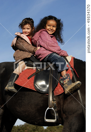 two riding little girls 49834370