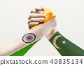 Two male hands competing in arm wrestling colored in Pakistan and India flags 49835134