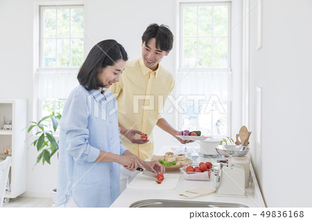 Couple cooking in the kitchen 49836168