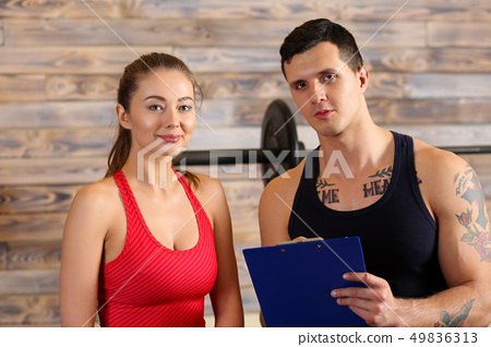 Sporty young smiling couple work out together