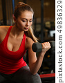 Sporty young woman work out biceps 49836329