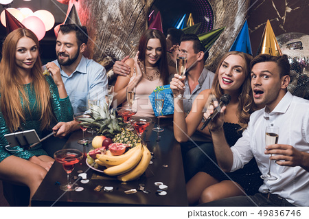 Young people are resting in a trendy nightclub. 49836746