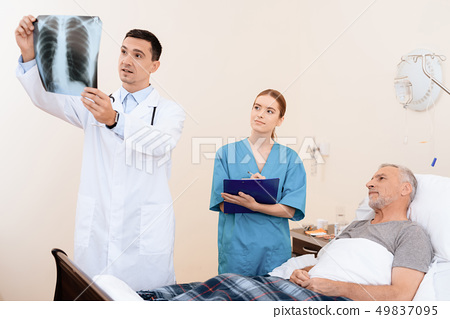 The old man lies on a cot in the medical ward. 49837095