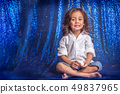 a long hair boy stand on blue glitter background 49837965