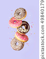 Sweet and colourful doughnuts falling or flying in 49840179