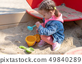 Cute little caucasian girl on the playground, 49840289