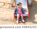 Cute little caucasian girl on the playground, 49840293