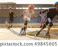 A girl training inline skating with other children 49845605