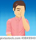 Sad frustrated man making facepalm gesture 49849940