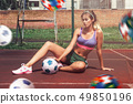 woman in sportswear with football ball 49850196