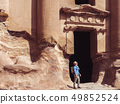 Tourist in a city of Petra in Jordan 49852524