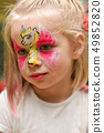 Portrait of a little girl with a unicorn pattern  49852820