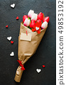 Bouquet of tulips and gift box on dark background. 49853192