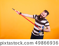 Funny bearded rockstar playing virtual guitar with broom 49866936