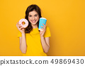 Happy excited girl with donut and coffee 49869430