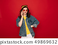 Hipster young girl talking by mobile phone 49869632