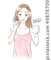 ผู้หญิงที่แปรงฟัน 49876700