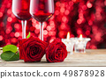 Rose and wineglasses. 49878928