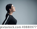 Closeup profile portrait of confident woman looking forward 49880977