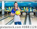 Smiling woman with bowling ball 49881128