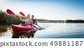 Beautiful couple sailing kayak on lake 49881187