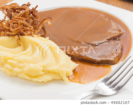 boiled veal in sauce with mashed potatoes 49882107