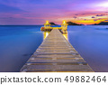 The bridge that stretches out the sea at sunset 49882464