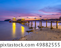 The bridge that stretches out the sea at sunset 49882555