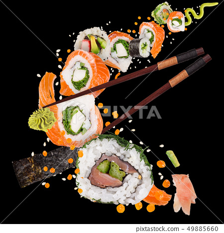 Pieces of delicious japanese sushi frozen in the air. 49885660