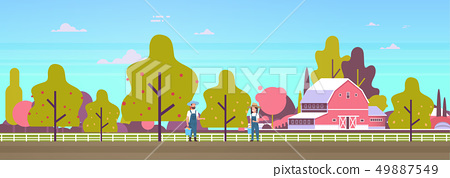 couple farmers picking pears from tree man woman gardeners harvesting ripe fruits gather harvest in 49887549